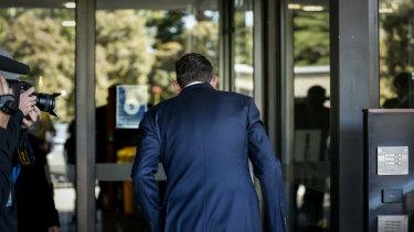 Premier Daniel Andrews entering the back entrance of Victorian Parliament on Thursday.