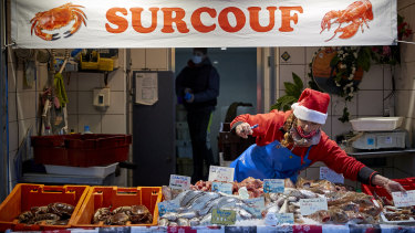 A fishmonger sets up her stall of at Boulogne-sur-Mer, France's largest fishing port, where the bulk of the catch comes from British waters. The EU is looking to maintain extensive access to the waters as part of a Brexit deal.