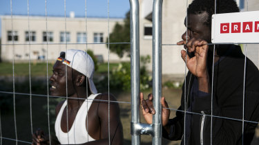 Migrants, mostly from Ivory Coast, Cameroon, Somalia, Eritrea and Senegal, held in a detention centre in an old school in Vydeniai, Lithuania.