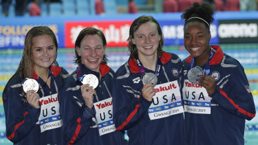United States women's 4x200m freestyle relay team pose with their silver medals.