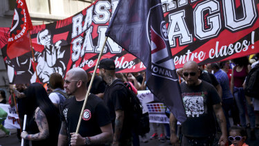 Members of the group RASH–SHARP Santiago ANTIFA (Anti-Fascism Action) attend a march in favour of migrants, organised by the National Immigrants Co-ordinator, in downtown Santiago last month.