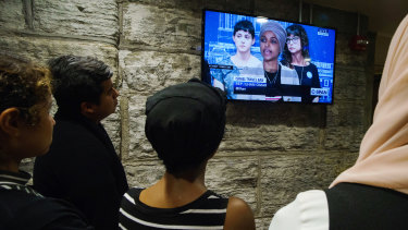 People gather in an overflow room to watch a news conference with representatives Ilhan Omar, a Democrat from Minnesota, and Rashida Tlaib, a Democrat from Michigan, not pictured, in St Paul, Minnesota.