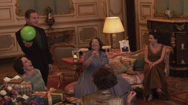 Olivia Colman, Ben Daniels, Marion Bailey and Helena Bonham-Carter in a scene from The Crown filmed in the Elizabeth Saloon at Belvoir Castle.