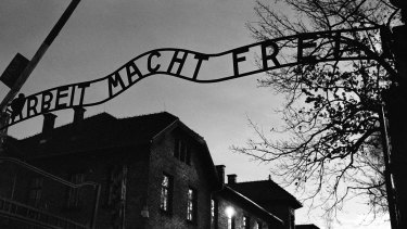 """The main entrance at the former Nazi death camp of Auschwitz in Oswiecim, Poland, with the inscription, """"Arbeit Macht Frei"""", which translates into English as '""""Work will set you Free""""."""