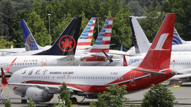 Dozens of grounded Boeing 737 MAX planes crowd a parking area near its factory in Seattle.