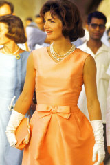 Jackie Kennedy wearing a triple strand of pearls on a visit to India.