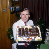 Brian Naylor holding a cake for Father of the Year.