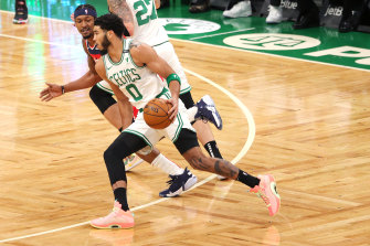 Bradley Beal defends against Jayson Tatum, who has since tested positive for COVID-19.