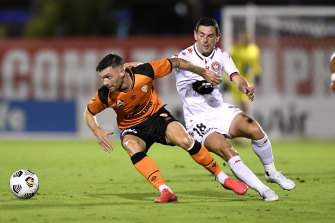 Jay O'Shea controls the ball under pressure from Graham Dorrans.