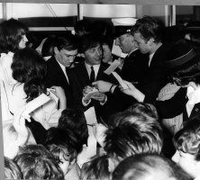 Gerry Marsden, (centre), is surrounded by fans during a personal appearance at the Southern Cross Hotel, Melbourne, to aid the Miss Teenage Quest and the Royal Hospital, in 1964.