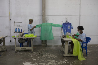 Instead of Carnival costumes, workers from the Vila Isabel samba school make scrubs for medical workers in Rio de Janeiro in April.