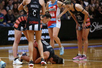 Kelsey Browne of the Magpies injured during the Round 13 Super Netball match.