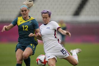 Australia's Ellie Carpenter and USA superstar Megan Rapinoe battle for the ball at the Tokyo Olympics.