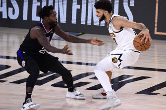 The Nuggets' Jamal Murray (right) takes on the Clippers' Patrick Beverley.