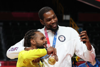 New Brooklyn teammates Patty Mills and Kevin Durant at the Tokyo Olympics.