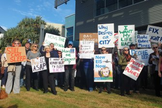 Brisbane residents protest aircraft noise outside the Brisbane Airport Corporation headquarters.