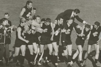 Jubilant Carlton players chair their elated coach, Ron Barassi, and captain John Nicholls after winning the 1968 grand final.
