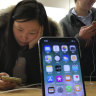 iPhone 5G boost as Apple settles $38b lawsuit