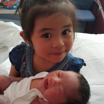 Caitlin, pictured with her baby sister Chloe.