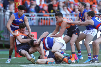 Tug of war: The first half was tightly contested, but the Giants kicked away in the third term.