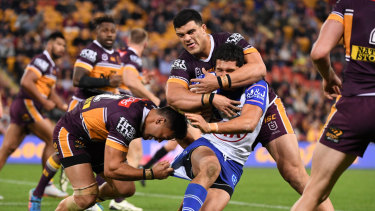 Crunch time: Canterbury's Dallin Watene-Zelezniak fails to crack the Broncos' defence.