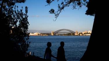 Walking beside Sydney Harbour.