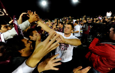 Glory days: Kieran Foran celebrates a premiership with Sea Eagles fans in 2011.