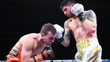 Duck and cover: Michael Zerafa lands a punch on Jeff Horn during their Australian Middleweight bout at Bendigo Stadium.