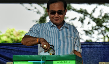 On course for victory: Prayut Chan-o-cha casts his vote on Sunday.