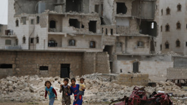 Children walk in the outskirts of al-Bab, northern Syria last week.