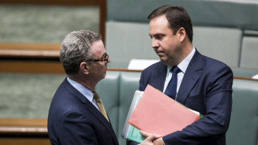 Christopher Pyne (left) speaks to Steve Ciobo in the House of Representatives.
