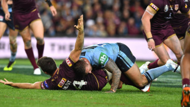 Brain snap: Tariq Sims tackles Ben Hunt without the ball.