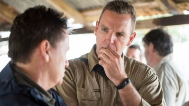 Greening Australia chief executive Brendan Foran listens to wetlands expert Niall Connolly.