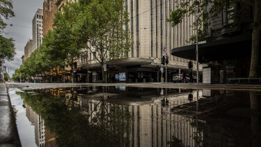 An empty Swanston Street was wet - and empty - all weekend.