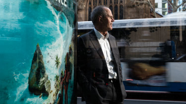 JCDecaux CEO, Steve O'Connor, next to a bus stop