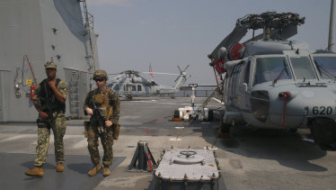 """US marines patrol the USS Blue Ridge as it anchors off Manila, Philippines. America has vowed to """"sail, fly and operate wherever the law allows us to"""" amid China's objections in the South China Sea."""