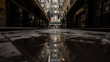 Degraves Street has been deserted during Melbourne's stage four lockdown and the Ombudsman said she would factor in COVID-19 hardship when it comes to prosecuting.