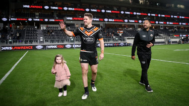 Benji Marshall takes a farewell lap with Chris Lawrence and his daughter.