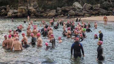 Bold and Beautiful Swimming Club members entering the water at Shelly Beach, less than a week after a shark attack in the same area.