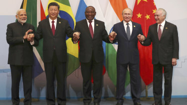 Members of the major emerging national economies group BRICS, with from left, Indian Prime Minister Narendra Modi, China's President Xi Jinping, South African President Cyril Ramaphosa, Russia's President Vladimir Putin, and Brazil's President Michel Temer.