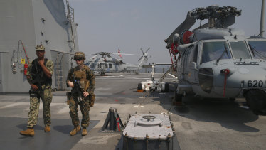 US marines patrol the USS Blue Ridge as it anchors off Manila, Philippines.