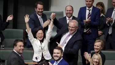 Liberal MP Gladys Liu is congratulated by Prime Minister Scott Morrison  after delivering her first speech in the House of Representatives in July 2019.