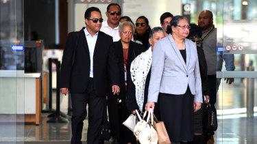 Supporters of Tuhirangi-Thomas Tahiata leave the Supreme Court in Brisbane on Monday.