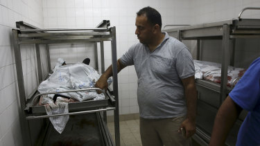 A medic covers the bodies of militants at the morgue of the European hospital east of Khan Younis, southern Gaza, on Friday.