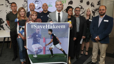 Campaign: Football officials and Human Rights Group members show their support for Hakeem last month.