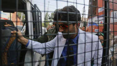 Indian police detain a Kashmiri doctor who staged a sit-in protest demanding restoration of landline and internet connectivity in hospitals in Srinagar, Indian controlled Kashmir, on Monday.