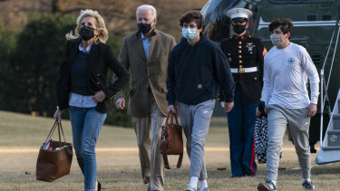 President Joe Biden and first lady Jill Biden with their grandchildren Hunter Biden, walk on the South Lawn upon arrival at the White House in Washington from a weekend trip to Wilmington, Delaware.