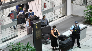 Australians evacuated from South America due to COVID-19 were met by police at Brisbane Airport on Tuesday.