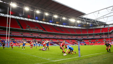 Ash Handley of Leeds Rhinos scores his sides second try at an empty Wembley.