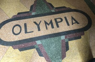 Now boarded up: a decorative feature on the floor of the old Olympia Milk Bar in Stanmore.